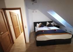 Schlafzimmer 3 Ferienwohnung 2