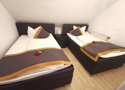 Schlafzimmer 4 Ferienwohnung 2
